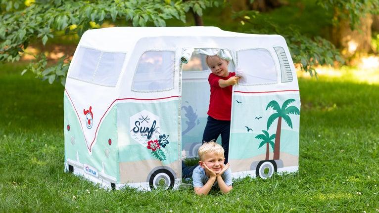 Children playing in camper van tent