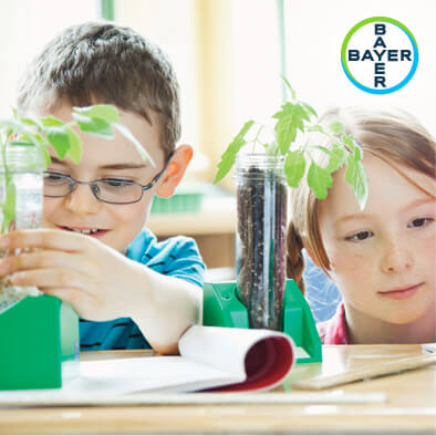 Bayer logo and kids with plants